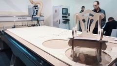 Wood router machine cutted pieces on display at business innovation exhibition Stock Footage