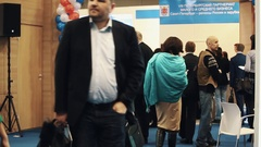 People crowd gathered in halls at business or politic exhibiton event Stock Footage