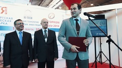 Businessman or politic talk in to microphone on scene at exposition event Stock Footage