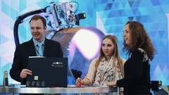 Managers joking talking on display at buisness innovation exhibition Stock Footage