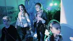 Kids crowd with mothers and grandmothers walk in purple lid room on event Stock Footage