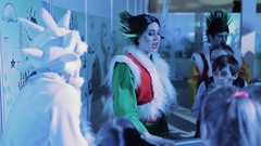 Christmas elf in mohawk entertaining kids in shopping mall playground Stock Footage
