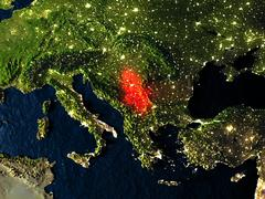 Serbia in red from space at night Stock Illustration