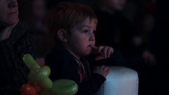 Boy in britain flag sweater interested looking off camera event theatre room Stock Footage