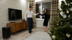 Lovely couple in artless but elegant dance at living room, private celebration Stock Footage