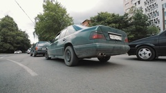 Camera riding on car route throught city streets of Kaliningrad in summertime Stock Footage