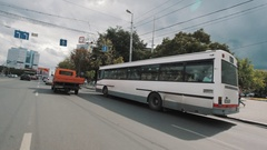 In car traffic city streets of Kaliningrad in summertime sunny day before rain Stock Footage