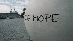 White concrete sphere with russian inscription sais Baltic Sea in summer sunny Stock Footage