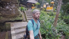 Island of Bali. An excursion on the island. The person in a blue shirt and with Stock Footage