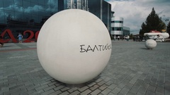 White concrete ball with russian inscription sais Baltic Sea in summer sunny day Stock Footage