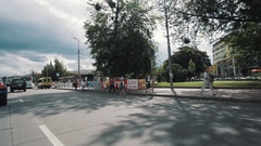 Moving along city streets of Kaliningrad in summertime sunny day before rain Stock Footage