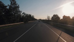 Cars riding on country asphalt route on sunset sunny day in summertime Stock Footage