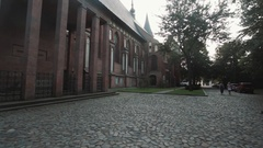 Cathedral building with watch tower in Kaliningrad Kneiphof on summer evening Stock Footage