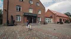 Red brick museum of sea building in Kaliningrad on summer sunny day Stock Footage