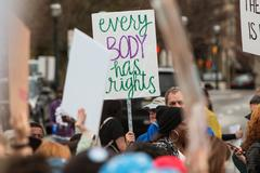 Man Holds Up Protest Sign In Atlanta Social Justice March Stock Photos