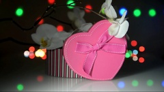 Gift box in form of heart on the background of the white orchid  Stock Footage