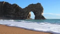 Beach by Durdle Door on the Jurassic Coast of Dorset, UK Stock Footage