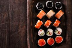 Various kinds of sushi served on a platter with soy sauce Stock Photos