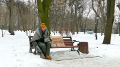 6 4K. Some food  for Homeless  adult man in cold  winter city park   Stock Footage