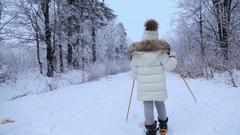 Child skiing in the winter forest Stock Footage