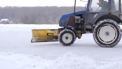 Tractor cleaning snow snowthrower Stock Footage