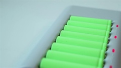 The charger a lot of the green lithium-ion batteries. Glide view Stock Footage