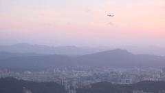 Plane is taking height, sunset in Taipei City. 4K Stock Footage