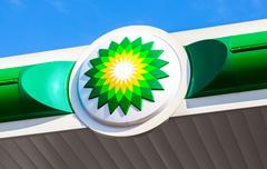 BP - British Petroleum petrol station logo over blue sky Stock Photos