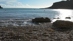 Sun reflecting on the sea and rocks at Lulworth Cove Stock Footage