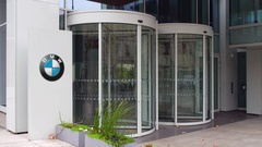 Street signage board with BMW logo. Modern office building. Editorial 4K 3D Stock Footage