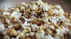 Grabbing Popcorn out of Bowl 4K Stock Footage