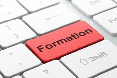 Studying concept: Formation on computer keyboard background Stock Illustration