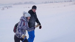 The family rises to snowy hill with snowtube. snow winter landscape. outdoors Stock Footage