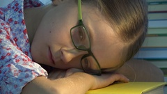 4K Eyeglasses Child Sleeping, Tired Eyes Girl Portrait, Much Reading, Studying Stock Footage