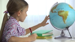 4K Child Studying Earth Globe, Girl Writing for School at Office, Learning Kid Stock Footage