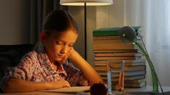 4K Child Reading Book, Girl Studying at Desk Lamp, Learning Children in Evening Stock Footage