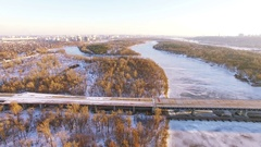 4K Aerial. Fly with camera inclination over frozen winter river and bridge Stock Footage