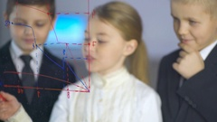 Kids discuss the graph at the virtual screen. Business science with children  Stock Footage
