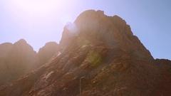 High lifeless mountain lit by the sun Stock Footage