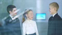 The kids discuss over the window. Business and science concept with children Stock Footage