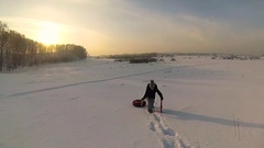 The girl rises to snowy hill with snowtube.slow motion. snow winter landscape Stock Footage