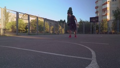 Caucasian sportsman playing street ball Stock Footage