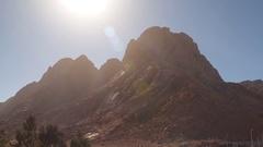 Lifeless mountain lit midday sun Stock Footage