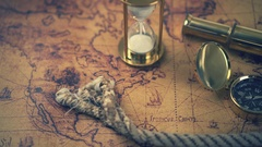 Vintage compass, telescope and other nautical equipment on ancient world map Stock Footage