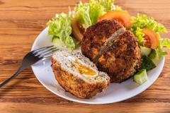 Scotch egg with vegetables Kuvituskuvat