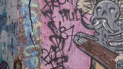 Graffiti Art Barbed Razor Wire Wall Tagging Gangs  4k Stock Footage