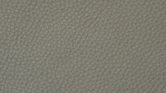 Leather texture surface. Close up of natural grain cow leather background. Dolly Stock Footage