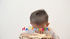 Portrait of funny child eating birthday cake, amusing dirty face Stock Footage