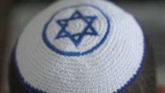 White kipah with blue Magen David on a man head, a symbol of Judaism and Zionism Stock Footage