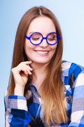 Happy smiling nerdy woman in weird glasses Stock Photos